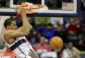 WASHINGTON, DC - JANUARY 06: JaVale McGee #34 of the Washington Wizards dunks over Amare Stoudemire #1 of the New York Knicks during the first half at Verizon Center on January 6, 2012 in Washington, DC.  NOTE TO USER: User expressly acknowledges and agre