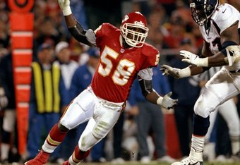 16 Nov 1998: Linebacker Derrick Thomas #58 of the Kansas City Chiefs in action against tackle Tony Jones #77 of the Denver Broncos during the game at the Arrowhead Stadium in Kansas City, Missouri. The Broncos defeated the Chiefs 30-7.