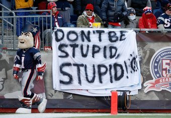 FOXBORO, MA - JANUARY 10:  Fans of the New England Patriots hold up a sign which reads 'Don't Be Stupid, Stupid!' against the Baltimore Ravens during the 2010 AFC wild-card playoff game at Gillette Stadium on January 10, 2010 in Foxboro, Massachusetts.  (
