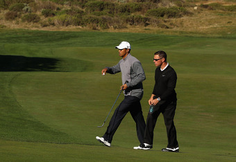 Woods with swing coach Sean Foley
