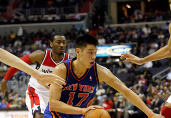 WASHINGTON, DC - FEBRUARY 08: Jeremy Lin #17 of the New York Knicks drives to the basket against the Washington Wizards during the first half at Verizon Center on February 8, 2012 in Washington, DC. NOTE TO USER: User expressly acknowledges and agrees tha