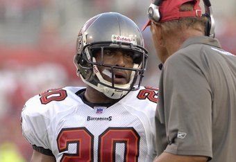 TAMPA, FL - AUGUST 10:  Cornerback Rhonde Barber #20 of the Tampa Bay Buccaneers talks to defensive coordinator Monte Kiffin during a preseason game against the New England Patriots at Raymond James Stadium on August 10, 2007 in Tampa, Florida. The Bucs w