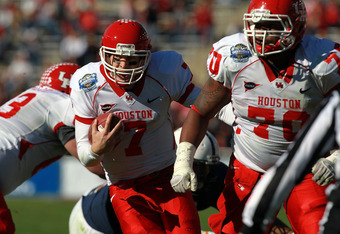 DALLAS, TX - JANUARY 02:  Case Keenum #7 of the Houston Cougars throws against the Penn State Nittany Lions during the TicketCity Bowl at Cotton Bowl Stadium on January 2, 2012 in Dallas, Texas.  (Photo by Ronald Martinez/Getty Images)