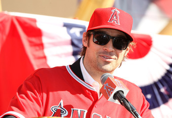 ANAHEIM, CA - DECEMBER 10:  C.J. Wilson speaks at a public press conference introducing newly signed Los Angeles Angels of Anaheim  players Albert Pujols and Wilson at Angel Stadium on December 10, 2011 in Anaheim, California.  (Photo by Stephen Dunn/Gett