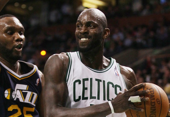 BOSTON, MA - JANUARY 21:  Kevin Garnett #5 of the Boston Celtics heads for the basket as Al Jefferson #25 of the Utah Jazz defends on January 21, 2011 at the TD Garden in Boston, Massachusetts.  The Celtics defeated the Jazz 110-86. NOTE TO USER: User exp