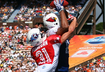 HONOLULU, HI - FEBRUARY 08: Wide receiver Larry Fitzgerald #11 of the NFC All-Stars Arizona Cardinals leaps and catches a 46 yard touchdown pass on the last play of the first half while covered by cornerback Cortland Finnegan #31 of the AFC All-Stars Tenn