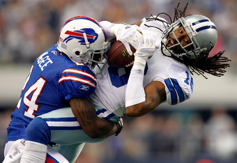 ARLINGTON, TX - NOVEMBER 13:  Jesse Holley #16 of the Dallas Cowboys pulls in a pass against  Terrence McGee #24 of the Buffalo Bills at Cowboys Stadium on November 13, 2011 in Arlington, Texas. The Dallas Cowboys beat the Buffalo Bills 44-7. (Photo by To
