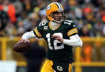 GREEN BAY, WI - JANUARY 15:  Aaron Rodgers #12 of the Green Bay Packers looks to pass against the New York Giants during their NFC Divisional playoff game at Lambeau Field on January 15, 2012 in Green Bay, Wisconsin.  (Photo by Jonathan Daniel/Getty Image