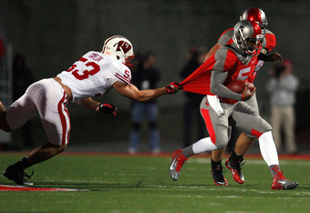 COLUMBUS, OH - OCTOBER 29:  Braxton Miller #5 of the Ohio State Buckeyes is dragged down by Tyler Dippel #53 of the Wisconsin Badgers during the second quarter on October 29, 2011 at Ohio Stadium in Columbus, Ohio. (Photo by Kirk Irwin/Getty Images)