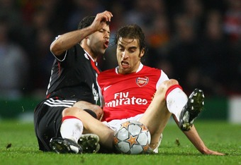 LONDON - APRIL 02:  Javier Mascherano of Liverpool is challenged by Mathieu Flamini of Arsenal during the UEFA Champions League Quarter Final 1st leg match between Arsenal and Liverpool at the Emirates Stadium on April 2, 2008 in London, England.  (Photo