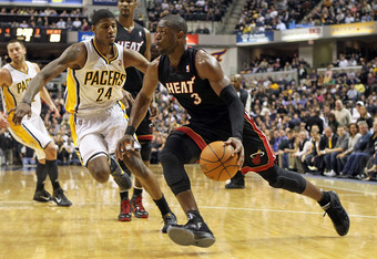 INDIANAPOLIS - FEBRUARY 15:  Dwyane Wade #3 of the Miami Heat dribbles the ball during the NBA game against the Indiana Pacers at Conseco Fieldhouse on February 15, 2011 in Indianapolis, Indiana.   The Heat won 110-103.   NOTE TO USER: User expressly ackn