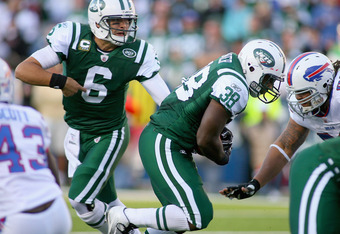 ORCHARD PARK, NY - NOVEMBER 06: Mark Sanchez #6 of the New York Jets hands off to John Conner #38 for a touchdown against the Buffalo Bills  at Ralph Wilson Stadium on November 6, 2011 in Orchard Park, New York.New York won 27-11.  (Photo by Rick Stewart/