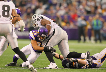 MINNEAPOLIS, MN - NOVEMBER 20:  Marcel Reece #45 of the Oakland Raiders gets tackled by Tyrell Johnson #25 and  Chad Greenway #52 of the Minnesota Vikings at the Hubert H. Humphrey Metrodome on November 20, 2011 in Minneapolis, Minnesota.  (Photo by Adam