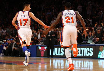 NEW YORK, NY - FEBRUARY 10:  (L-R) Jeremy Lin #17 and Iman Shumpert #21 of the New York Knicks celebrate a play against the Los Angeles Lakers at Madison Square Garden on February 10, 2012 in New York City.  NOTE TO USER: User expressly acknowledges and a