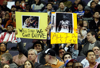 WASHINGTON, DC - FEBRUARY 08:  Fans of Jeremy Lin #17 of the New York Knicks hold up signs during the second half of the Knicks and Washington Wizards game at Verizon Center on February 8, 2012 in Washington, DC.  NOTE TO USER: User expressly acknowledges