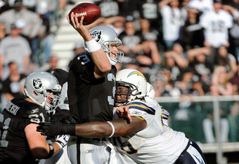 OAKLAND, CA - JANUARY 01:  Carson Palmer #3 of the Oakland Raiders gets his pass off under pressure from Cam Thomas #76 of the San Diego Chargers at O.co Coliseum on January 1, 2012 in Oakland, California.  (Photo by Thearon W. Henderson/Getty Images)
