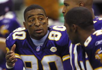 7 Oct 2001: Cris Carter #80 talks with teammates Daunte Culpepper #11 and Randy Moss #84 of the Minnesota Vikings during the game against the New Orleans Saints at the Superdome in New Orleans, Louisiana. The Saints won 28-15. DIGITAL IMAGE. Mandatory Cre
