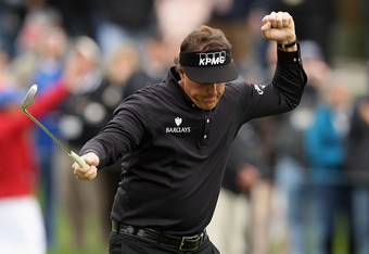 PEBBLE BEACH, CA - FEBRUARY 12:  Phil Mickelson celebrates his par-saving putt on the 15th hole during the final round of the AT&T Pebble Beach National Pro-Am at Pebble Beach Golf Links on February 12, 2012 in Pebble Beach, California. Mickelson won with
