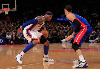 NEW YORK, NY - JANUARY 31:  Carmelo Anthony #7 of the New York Knicks drives against Austin Daye #5 of the Detroit Pistons at Madison Square Garden on January 31, 2012 in New York City.  NOTE TO USER: User expressly acknowledges and agrees that, by downlo
