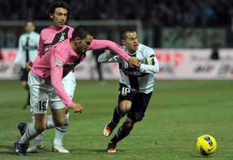 PARMA, ITALY - FEBRUARY 15:  Sebastian Giovinco (R) of Parma FC is challenged by Leonardo Bonucci of Juventus FC during the Serie A match between Parma FC and Juventus FC at Stadio Ennio Tardini on February 15, 2012 in Parma, Italy.  (Photo by Valerio Pen