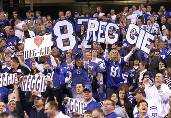INDIANAPOLIS, IN - DECEMBER 22: Indianapolis Colts fans cheer for Reggie Wayne #87 after he made the game-winning touchdown reception against the Houston Texans at Lucas Oil Stadium on December 22, 2011 in Indianapolis, Indiana. The Colts defeated the Tex