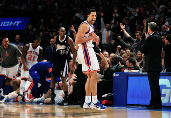 NEW YORK, NY - FEBRUARY 15: Landry Fields #2 of the New York Knicks reacts after a three point shot from his teammate Steve Novak #16 of the New York Knicks against the Sacramento Kings at Madison Square Garden on February 15, 2012 in New York City. NOTE