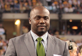 ARLINGTON, TX - FEBRUARY 06:  Pro Football Hall of Fame Class of 2011 member Marshall Faulk stands on the field prior to Super Bowl XLV between the Pittsburgh Steelers and the Green Bay Packers at Cowboys Stadium on February 6, 2011 in Arlington, Texas.