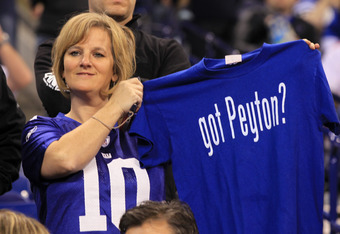 INDIANAPOLIS, IN - JANUARY 31:  A fan holds up a t-shirt which reads 'got Peyton' in reference to quarterback Peyton Manning of the Indianapolis Colts during Media Day ahead of Super Bowl XLVI between the New England Patriots and the New York Giants at Lu