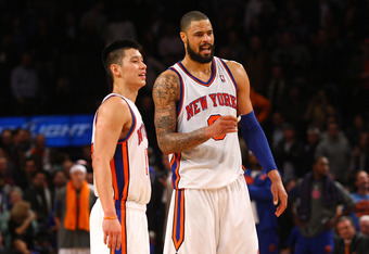 NEW YORK, NY - FEBRUARY 10:  (L-R) Jeremy Lin #17 and Tyson Chandler #6 of the New York Knicks look on against the Los Angeles Lakers at Madison Square Garden on February 10, 2012 in New York City.  NOTE TO USER: User expressly acknowledges and agrees tha