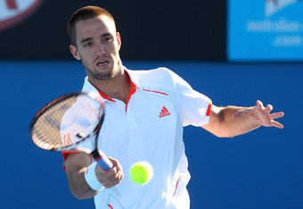 MELBOURNE, AUSTRALIA - JANUARY 19:  Viktor Troicki of Serbia plays a forehand in his second round match against Mikhail Kukushkin of Kazakhstan during day four of the 2012 Australian Open at Melbourne Park on January 19, 2012 in Melbourne, Australia.  (Ph