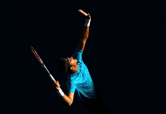 MELBOURNE, AUSTRALIA - JANUARY 24:  Juan Martin Del Potro of Argentina serves in his quarter final match against Roger Federer of Switzerland during day nine of the 2012 Australian Open at Melbourne Park on January 24, 2012 in Melbourne, Australia.  (Phot