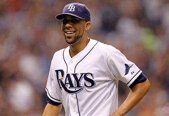ST. PETERSBURG - OCTOBER 03:  Pitcher David Price #14 of the Tampa Bay Rays smiles as he walks back to the dugout against the Texas Rangers during Game Three of the American League Division Series at Tropicana Field on October 3, 2011 in St. Petersburg, F