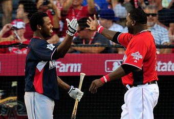 ANAHEIM, CA - JULY 12:  National League All-Star Hanley Ramirez #2 of the Florida Marlins and American League All-Star David Ortiz #34 of the Boston Red Sox shake hands on the field during the second round of the 2010 State Farm Home Run Derby during All-