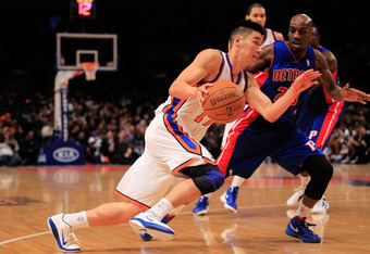NEW YORK, NY - JANUARY 31: Jeremy Lin #17 of the New York Knicks drives past Detroit Pistons Walker Russell #23 of the Detroit Pistons at Madison Square Garden on January 31, 2012 in New York City.  NOTE TO USER: User expressly acknowledges and agrees tha