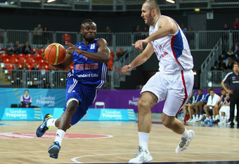 LONDON, ENGLAND - AUGUST 18:  Milan Macvan of Serbia tries to stop Ogo Adegboye of Great Britain during the match between Great Britain and Serbia at the Basketball Arena on August 18, 2011 in London, England.  (Photo by Julian Finney/Getty Images)