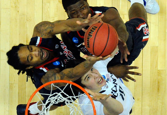 ANAHEIM, CA - MARCH 26:  Jesse Perry #33 and Solomon Hill #44 of the Arizona Wildcats fight for a rebound against Tyler Olander #10 of the Connecticut Huskies during the west regional final of the 2011 NCAA men's basketball tournament at the Honda Center