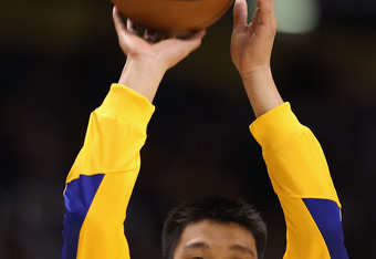 PHOENIX - OCTOBER 19:  Jeremy Lin #7 of the Golden State Warriors warms up before the preseason NBA game against the Phoenix Suns at US Airways Center on October 19, 2010 in Phoenix, Arizona. NOTE TO USER: User expressly acknowledges and agrees that, by d