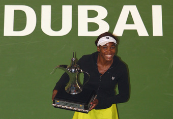 DUBAI, UNITED ARAB EMIRATES - FEBRUARY 20:  Venus Williams of the USA poses with her winners trophy after her final match against Victoria Azarenka of Belarus during day seven of the WTA Barclays Dubai Tennis Championships at the Dubai Tennis Stadium on F