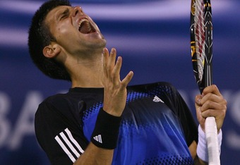 DUBAI, UNITED ARAB EMIRATES - MARCH 07:  Novak Djorkovic of Serbia reacts after losing a point against Andy Roddick of United States during the ATP Barclays Dubai Tennis Championships at the Dubai Tennis Stadium on March 7, 2008 in Dubai, United Arab Emir