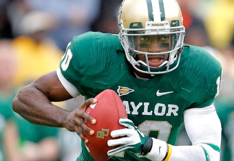 WACO, TX - DECEMBER 03: Robert Griffin III #10 of the Baylor Bears runs during a game against the Texas Longhorns at Floyd Casey Stadium on December 3, 2011 in Waco, Texas.  (Photo by Sarah Glenn/Getty Images)