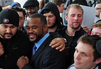 ATLANTA, GA - FEBRUARY 16: Fighter Rashad Evans poses with fans after a press conference promoting UFC 145: Jones v Evans at Philips Arena on February 16, 2012 in Atlanta, Georgia. (Photo by Scott Cunningham/Getty Images)