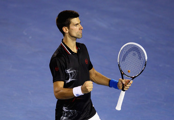 MELBOURNE, AUSTRALIA - JANUARY 29:  Novak Djokovic of Serbia celebrates a point in his men's final match against Rafael Nadal of Spain during day fourteen of the 2012 Australian Open at Melbourne Park on January 29, 2012 in Melbourne, Australia.  (Photo b