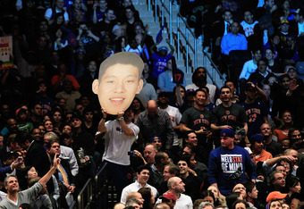 NEW YORK, NY - FEBRUARY 15: Jeremy Lin #17 of the New York Knicks fans cheer him on against the Sacramento Kings at Madison Square Garden on February 15, 2012 in New York City. NOTE TO USER: User expressly acknowledges and agrees that, by downloading and/