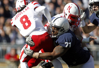STATE COLLEGE, PA - NOVEMBER 12:  Devon Still #71 of the Penn State Nittany Lions tackles Ameer Abdullah #8 of the Nebraska Cornhuskers during the game on November 12, 2011 at Beaver Stadium in State College, Pennsylvania.  (Photo by Justin K. Aller/Getty