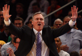 NEW YORK, NY - FEBRUARY 10: Head coach Mike D'Antoni of the New York Knicks reachs as he coaches against the Los Angeles Lakers at Madison Square Garden on February 10, 2012 in New York City.  NOTE TO USER: User expressly acknowledges and agrees that, by