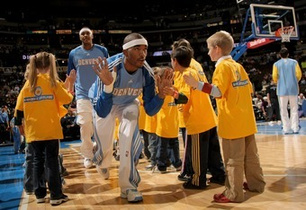 DENVER - NOVEMBER 17:  J. R. Smith #1 of the Denver Nuggets high fives young fans before facing the New York Knicks at the Pepsi Center November 17, 2007 in Denver, Colorado. The Nuggets defeated the Knicks 115-83.  (Photo by Doug Pensinger/Getty Images)