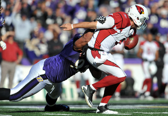 BALTIMORE - OCTOBER 30:  Kevin Kolb #4 of the Arizona Cardinals fumbles the ball after being tackled by Haloti Ngata #92 of the Baltimore Ravens at M&T Bank Stadium on October 30. 2011 in Baltimore, Maryland. The Ravens defeated the Cardinals 30-27. (Phot