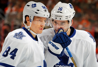 PHILADELPHIA, PA - FEBRUARY 09:  Clarke MacArthur #16 and Mikhail Grabovski #84 of the Toronto Maple Leafs talk as they wait for a faceoff during an NHL hockey game against the Philadelphia Flyers at Wells Fargo Center on February 9, 2012 in Philadelphia,