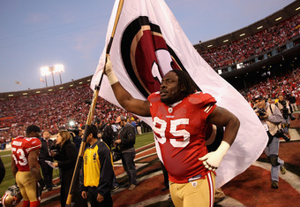 SAN FRANCISCO, CA - JANUARY 14: Ricky Jean Francois #95 of the San Francisco 49ers celebrates after they beat the New Orleans Saints in the NFC Divisional playoff game at Candlestick Park on January 14, 2012 in San Francisco, California.  (Photo by Ezra S