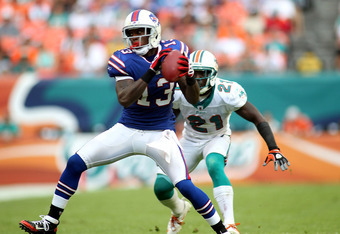 MIAMI GARDENS, FL - NOVEMBER 20:  Receiver Stevie Johnson #13 of the Buffalo Bills makes a catch in front of Cornerback Vontae Davis #21 of the Miami Dolphins at Sun Life Stadium on November 20, 2011 in Miami Gardens, Florida.  (Photo by Marc Serota/Getty